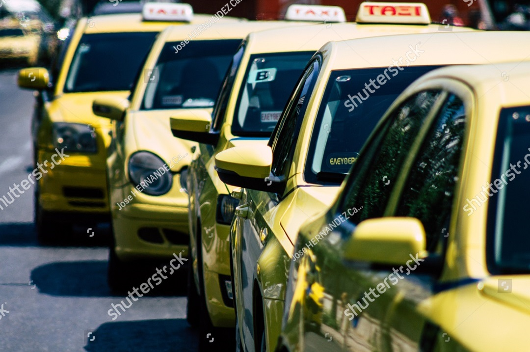 stock-photo-athens-greece-august-view-of-greek-yellow-taxis-rolling-through-the-streets-of-athens-in-1490504276